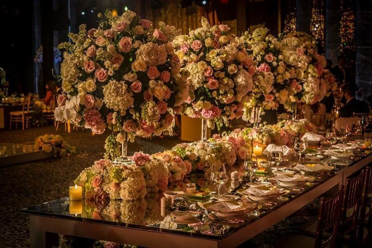 Lush Floral Decor and Elegant Lighting Lush Floral Decor and Elegant Lighting garden roses hydrangea orchids lighting centerpieces menu cards place settings votives reception Exquisite Events Firenze Flora Itsoura Photography Master Production Raffles Hotel