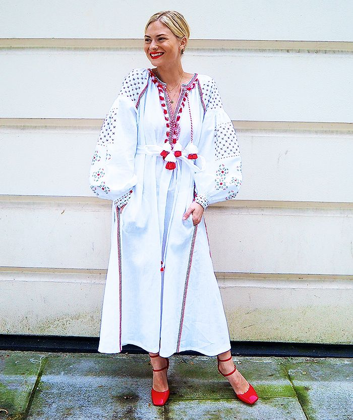 Blogger Pandora Sykes wears a bohemian white and red maxi dress with embroidery and tassel detailing and red strappy pumps