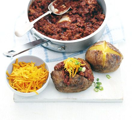 Turkey mince is cheap and lean - flavour Mexican-style with cumin and paprika and serve in crisp baked potatoes