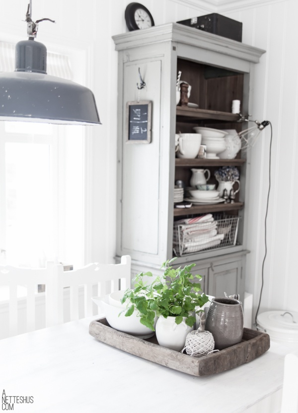 The soft grey of the cabinet works so well against the white walls. Everything just pops out!