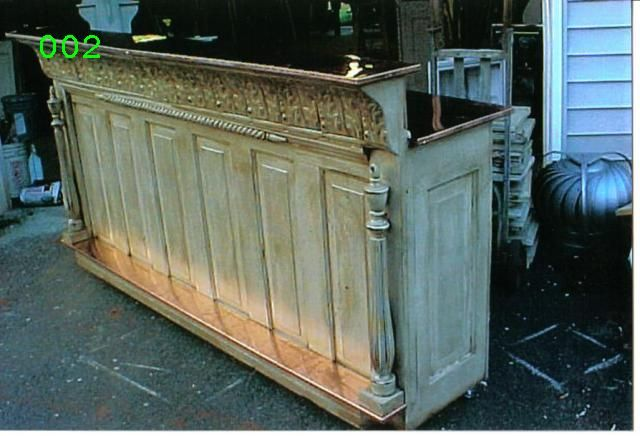 A bar made of reused doors, and the top is a tin shelf. I love it!