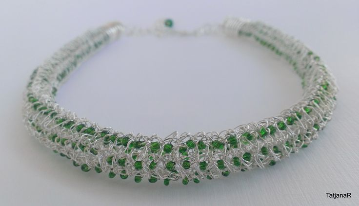 Necklace, crochet with silver pleated cooper wire and glass beads.