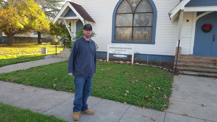 David Edward Stone Jr standing in front of the Methodist Church in Le Grand, CA. His mother grew up here and attended church here.