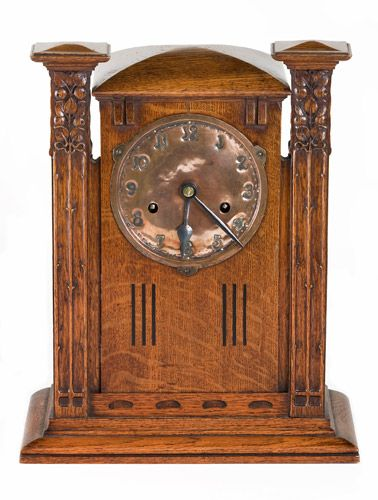 John Ednie (1876-1934) - Mantel Clock. Carved & Inlaid Oak with Hammered Copper Dial. Glasgow, Scotland. Circa 1900.