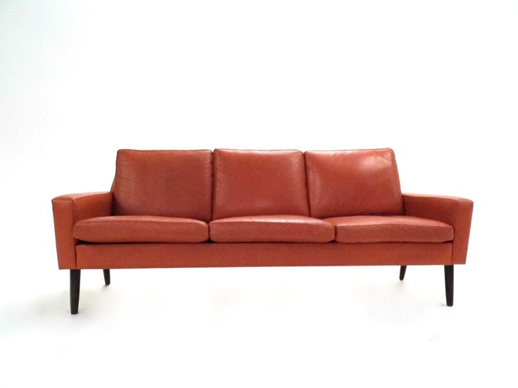 A beautiful Danish orange tan leather three seater sofa, this would make a stylish addition to any living or work area.   The sofa has wide cushions and sculptured padded armrests for enhanced comfort. A striking piece of classic Scandinavian furniture.  The sofa is in excellent condition with minimal signs of wear and tear relating to age. The soft leather has a lovely worn in feel.  Width: 180cm, Depth: 72cm, Height: 78cm, Seat Pad Hei...