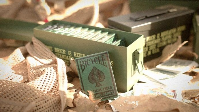 These playing card canisters were inspired by US military ammunition boxes. Comes in Original and Black Ops. The Black Ops version comes fully stocked with 12 decks of cards.