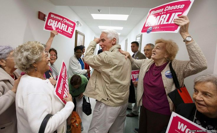 Former Florida Governor and Democratic gubernatorial candidate Charlie Crist (centre) heads out of the Mid-County Senior Center