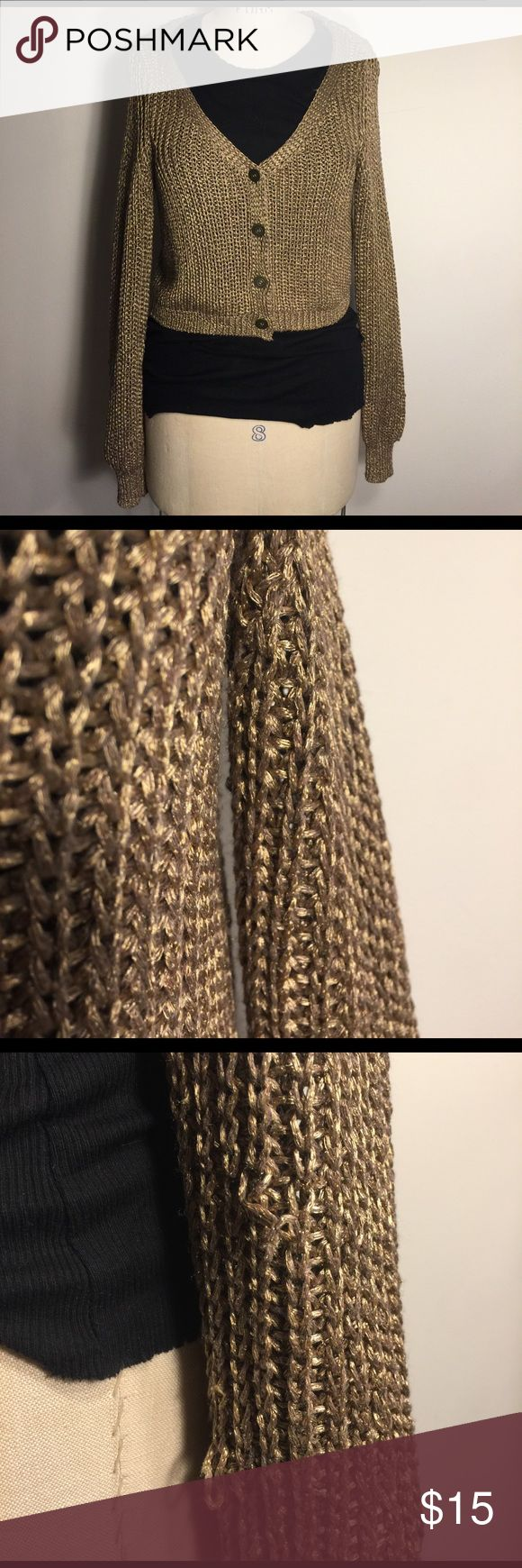 Free People shimmer gold cardigan Rarely worn, but a few yarns are pulled as shown in photo. Pretty good shimmer yarn. Free People Sweaters Cardigans