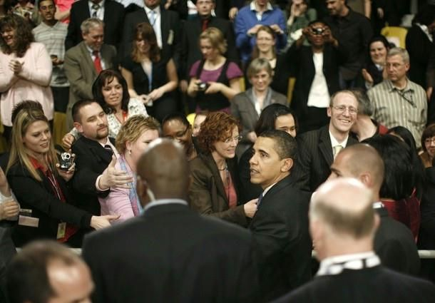 U.S. President Barack Obama  meets members of the audience during a Town Hall meeting in Strasbourg April 3, 2009. The North Atlantic Treaty Organisation (NATO) military alliance is celebrating its 60th anniversary at a summit co-hosted by Germany and France.