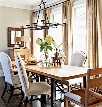 Master Mix In this dining room, old meets new to great effect. Traditional upholstered dining chairs mix with modern hide-covered host chairs around an industrial table covered with a French oak top.