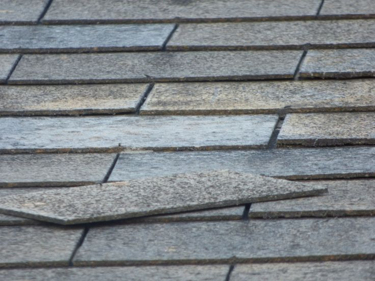 Asbestos roof times on a shopping center.