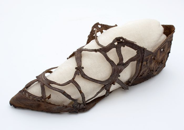 Shoes: ca. 1600-1660, Netherlands, leather embellished with crossed leather laces and decorations of crosses and flower motifs.