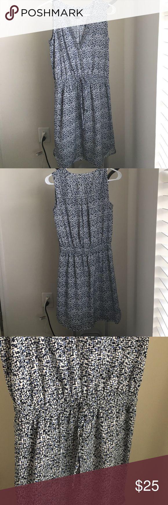Ann Taylor Drawstring Waist Dress Blue and white patterned v-neck dress. Drawstring waist. 100% polyester, 5% spandex. Ann Taylor Dresses
