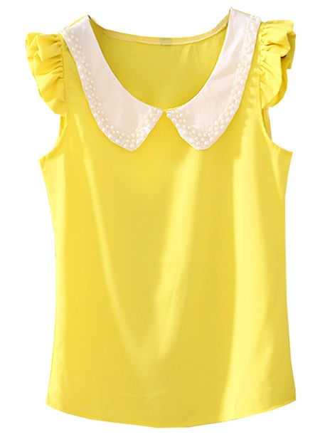 Yellow Ruffles and white color. Pair it with white or navy shorts and neutral flats.