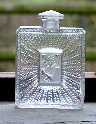 La Belle Saison.  A lovely rare perfume bottle in clear frosted glass heightened with pale sepia staining, c. 1920.