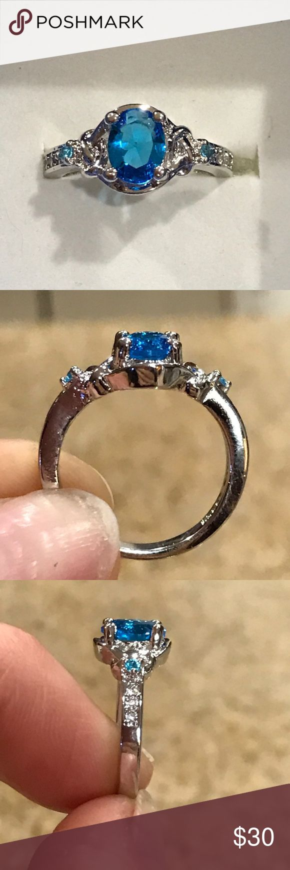 Victorian inspired blue and white topaz ring Size 7, lab created blue and white topaz set in 925 silver overlay. Beautiful modern Victorian inspired details. Jewelry Rings