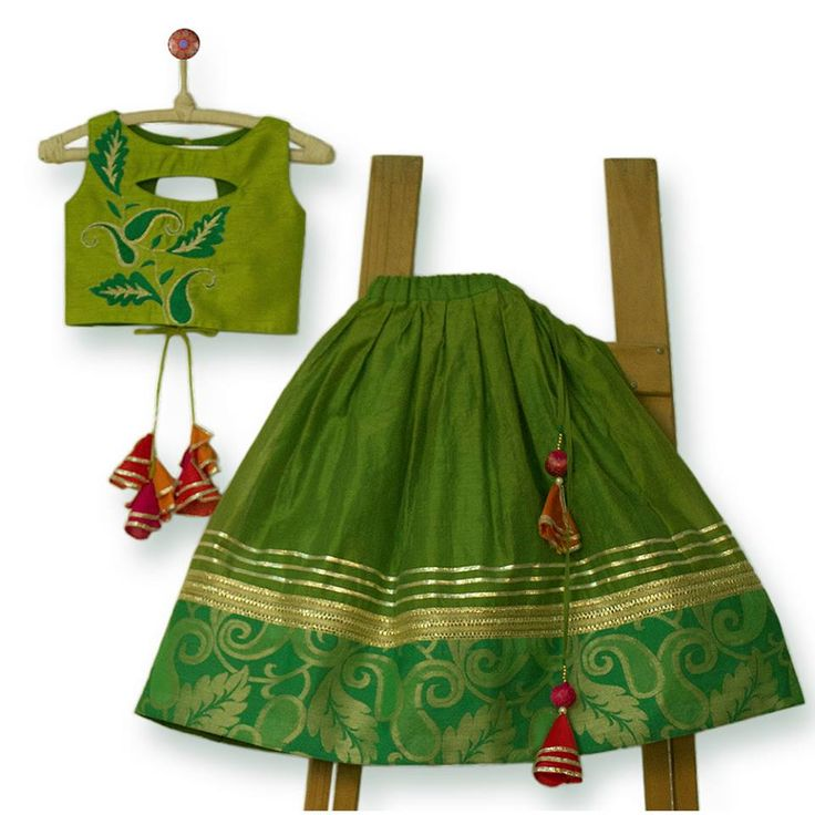 Beautiful Ghagra Choli with handmade big tassels and embroidered peek-a -boo top which girls would love to wear.