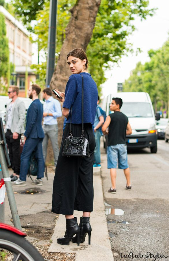 Womenswear Street Style by Ángel Robles. Fashion Photography from Milan Fashion Week. Culotte pants with ankle boots and Louis Vuitton mini bag. On the street, Via Valtellina, Milano.