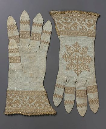 Pair of ecclesiastical gloves        Spanish, 15th–16th century (about 1520)         Spain  Dimensions      L: 30 cm (11 13/16 in.)  Medium or Technique      Silk and gilt-silver yarns, knitted    Accession Number      38.1259a-b