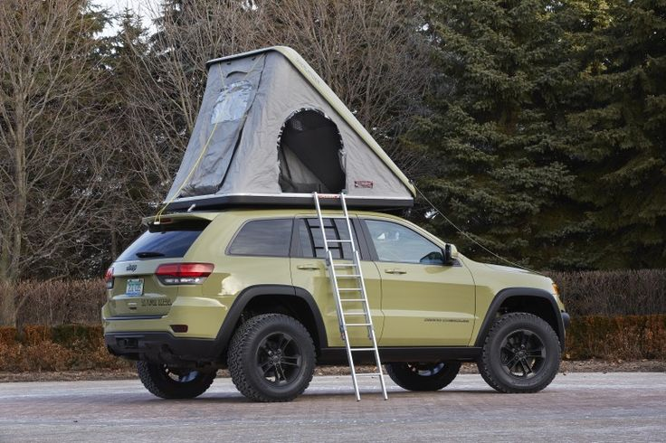 The Grand Cherokee Overlander includes a clamshell roof tent for camping