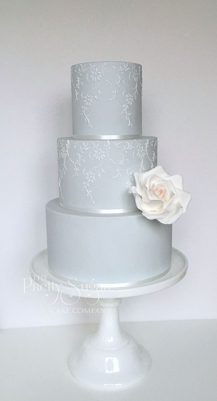 Pale blue with delicate vintage lace detail wedding cake