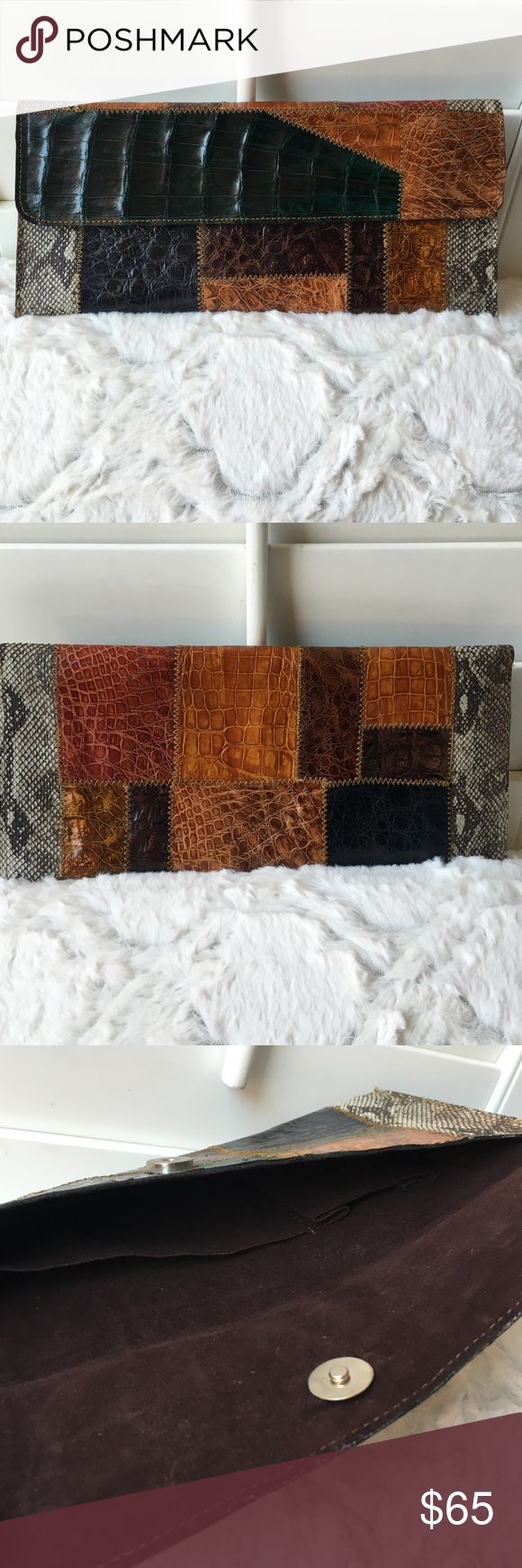 Genuine snake alligator envelope clutch Authentic. Genuine. Artisan. Boutique from travels. Gently used once. Gorgeous Multi colored patchwork design. Interior is skinny but had 2 small pockets. Rectangular shape. Pristine condition. Variety of colors forest green Browns neutral colors. Fall fashion. Bags Clutches & Wristlets