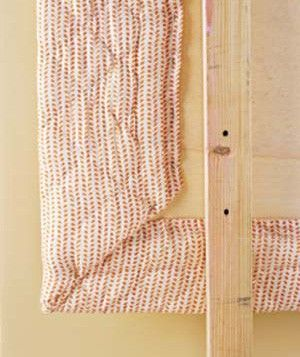How to use a quilt to create an upholstered headboard.