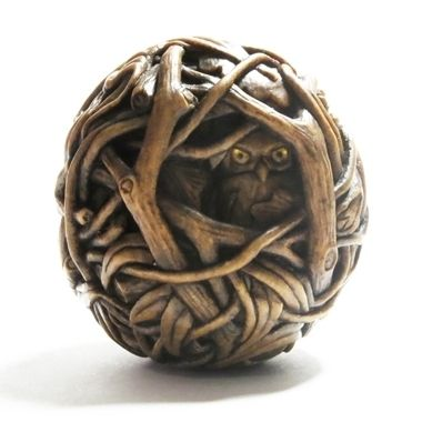 Susan Wraight: Midnight, 2013. Netsuke, hand-carved & stained boxwood, inlaid amber and gold leaf. Height 4.5cm Diameter 5cm