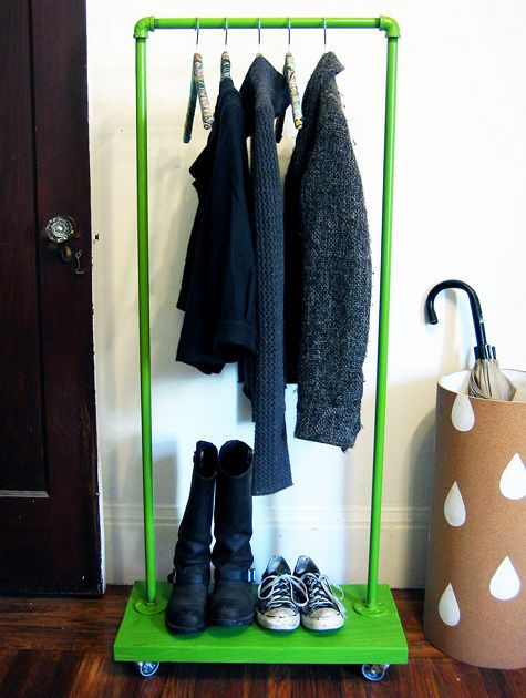 Instead of hanging jackets on a coat rack, use a small clothes rack for a clean and neat entry.