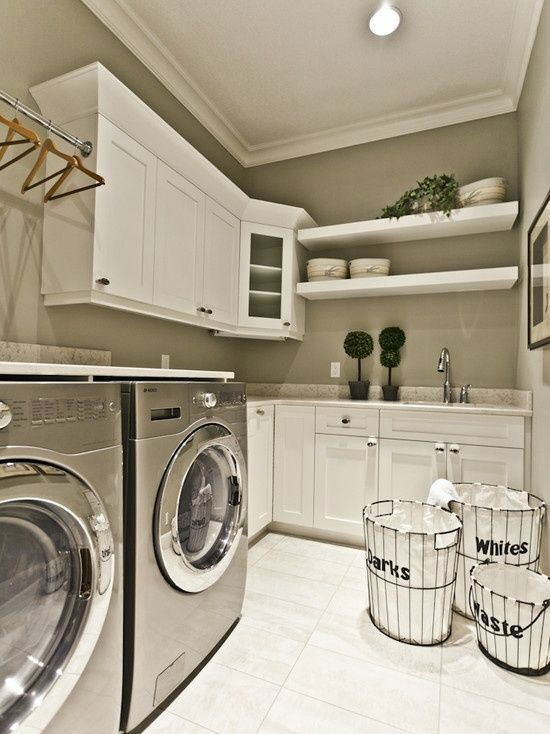 This all goes together well!!.. white cabinets, grey washer and dryer and the paint color..