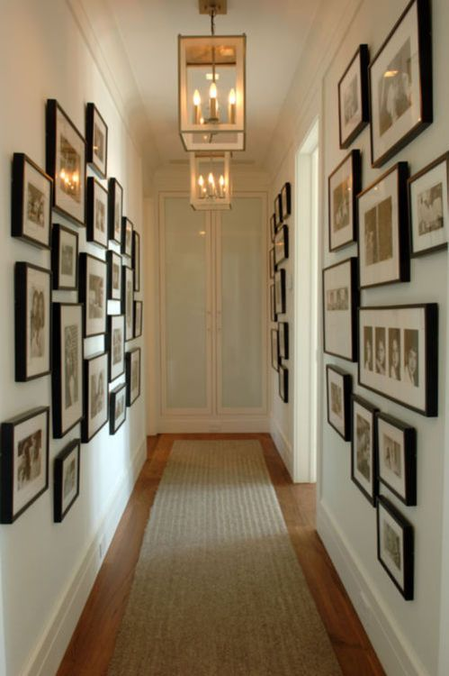 Hallway decorating idea. Paint walls a light blue or green. Make a gallery wall using simple black frames.