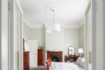 A remnant of the old home remains in this bedroom