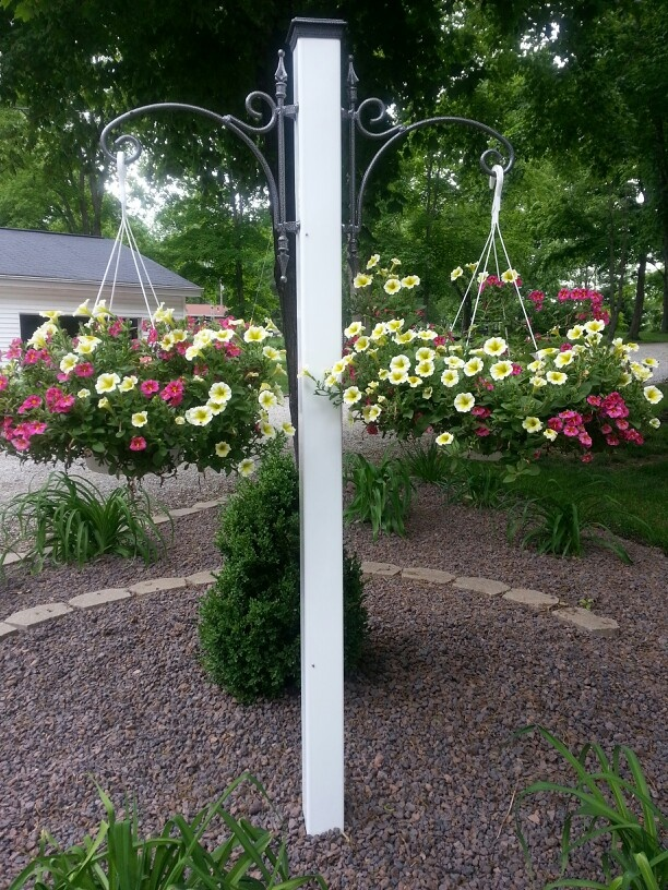 Hanging basket post that my husband made me because my baskets were to heavy for store bought posts. Love it!