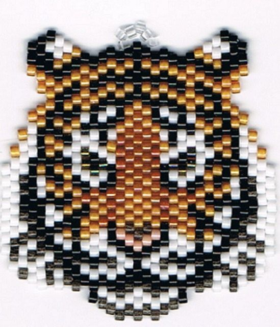 "Beaded tiger for earrings. Design by Linda K. Hampton and beaded by ESTY shop owner using 608 small delica beads and 9 colors in each earring. They measure 1.5"" x 1.5""."