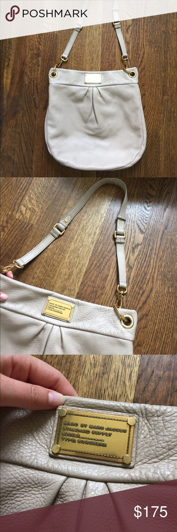Marc By Marc Jacobs Leather Hobo Bag Beautiful and neutral sand color with gold hardware. Top handle and cross body strap. Minor imperfections shown in photo. Not noticeable at all. Inner zipper and two pockets in the inside lining. In near perfect condition. Love this bag but looking for something smaller. Marc By Marc Jacobs Bags Hobos