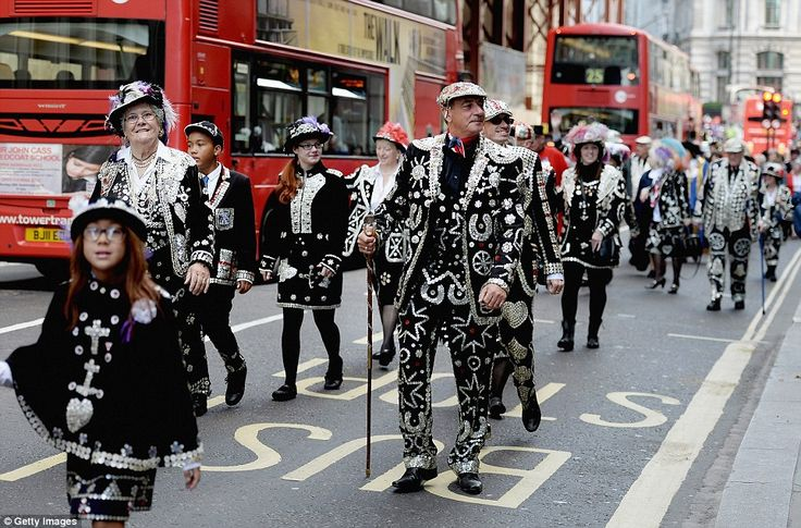London's alternative Royals: the procession of Pearly Kings and Queens lit up the capital today as they paraded the streets in extravagant outfits covered top to toe in sparkly buttons, badges and glitter