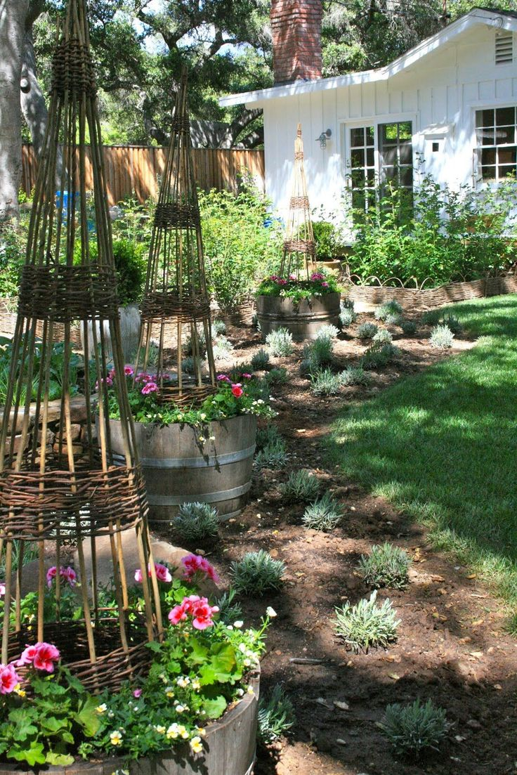 wattle/cane growing pyramids in containers to extend gardening spaces