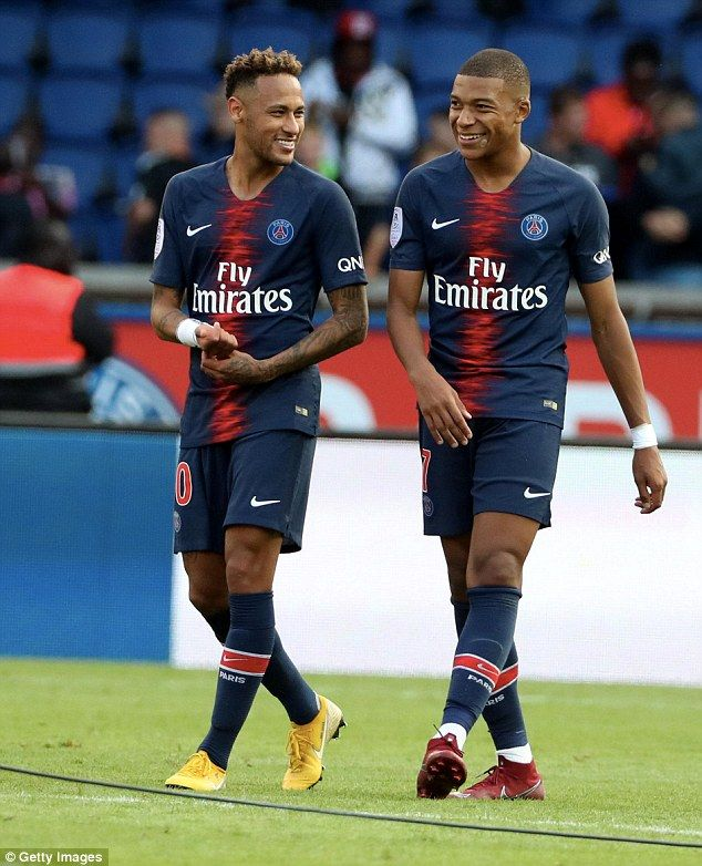 ed3f8f71e6f Attacking duo Neymar and Mbappe share a joke as they leave the pitch at the  end of the match
