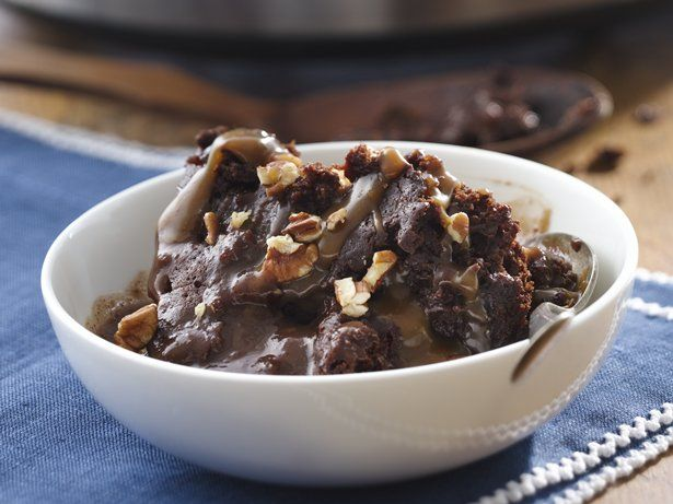 Slow Cooker Turtle Pudding - Ooey gooey chocolate pudding, caramel and pecans make this slow cooker dessert extra delicious.