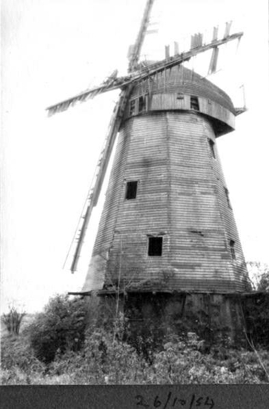 South Ockendon smock Mill, near Thurrock, Essex. Built alongside a watermill it ceased work in about 1920 and, despite preservation efforts, deteriorated and eventually collapsed in 1977. Today all that remains are the foundations, very overgrown, but the windshaft, that carries the sails, has found a new lease of life in the restored Ockley mill in Surrey.