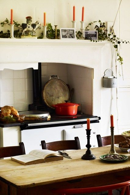 The kitchen of the designer Ben Pentreath of Pentreath & Hall's Dorset parsonage is a working space, so decorations are kept to coloured candles and ivy.
