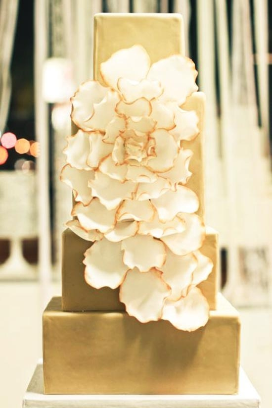 Sweet and Saucy Shop - Long Beach, CA    And last but not least, this elegant gold number with a modern white bloom flowing over each yummy layer.