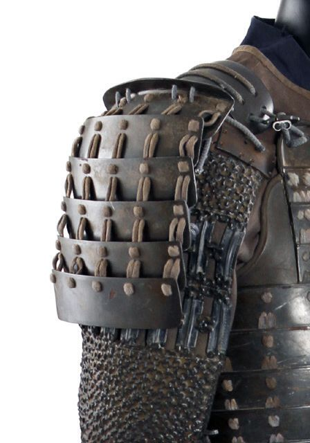 Sode shoulder armour. Armour detailing, layering, lamellar. Was first used around the 4th century. Some materials used were small iron, leather scales or plates as well as being connected to materials such as rivets and lace.                                                                                                                                                     More