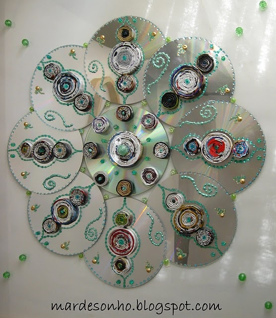 CD mandala - interesting use for unplayable cds.  Glue cds together and add your choice of embellishments.  Viola'