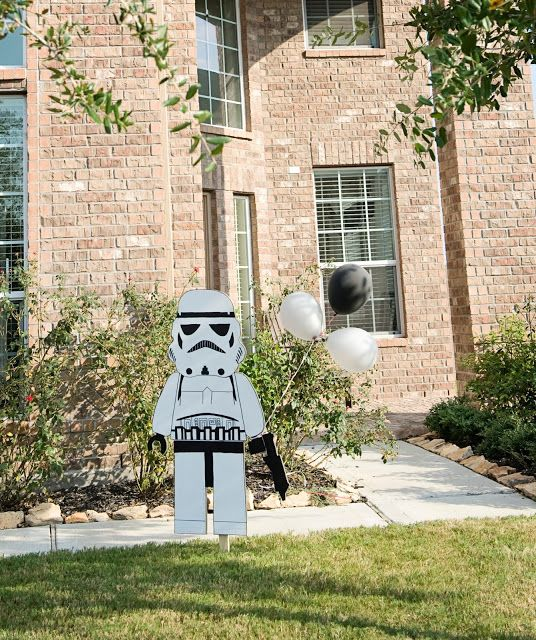 Stormtropper holding balloons entrance idea