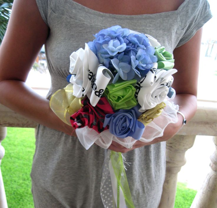 You know the drill. Collect all of the ribbons and bows from the bridal shower to create a bouquet for the bride-to-be to use at the wedding rehearsal. But, why should the bride carry a tacky bou…