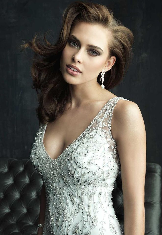 Incredibly beautiful, beaded, overlay, wedding dress with straps, from Allure Bridal. Front view.