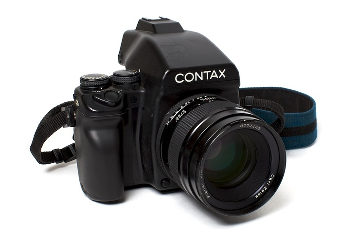 Contax 645 - The Contax 645 is an enlarged version of a 35mm SLR. It shoots 16 images on a roll of medium format 120 film with negatives that have about 3 times the information (resolution) of a 35mm negative. It is typically paired with a Carl Zeiss 80mm f/2 lens which produces images with an equivalent rendering of what a 45mm f/1.0 lens would on a 35mm camera. The extremely shallow depth of field the Contax 645 is capable of has made this the camera of choice among a growing number of…