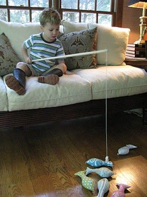 Dowel fishing pole, magnet (for the hook) and stuffed fish with washer's attached.  Cute, Fun Idea!!!