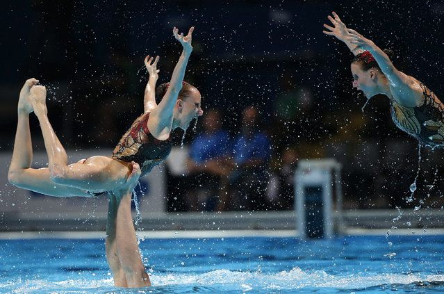Russia perform their routine in the synchronised swimming team free preliminary event at the FINA Swimming World Championships in Barcelona, Spain,  Tuesday, July 23, 2013. (Photo by Emilio Morenatti/AP Photo)